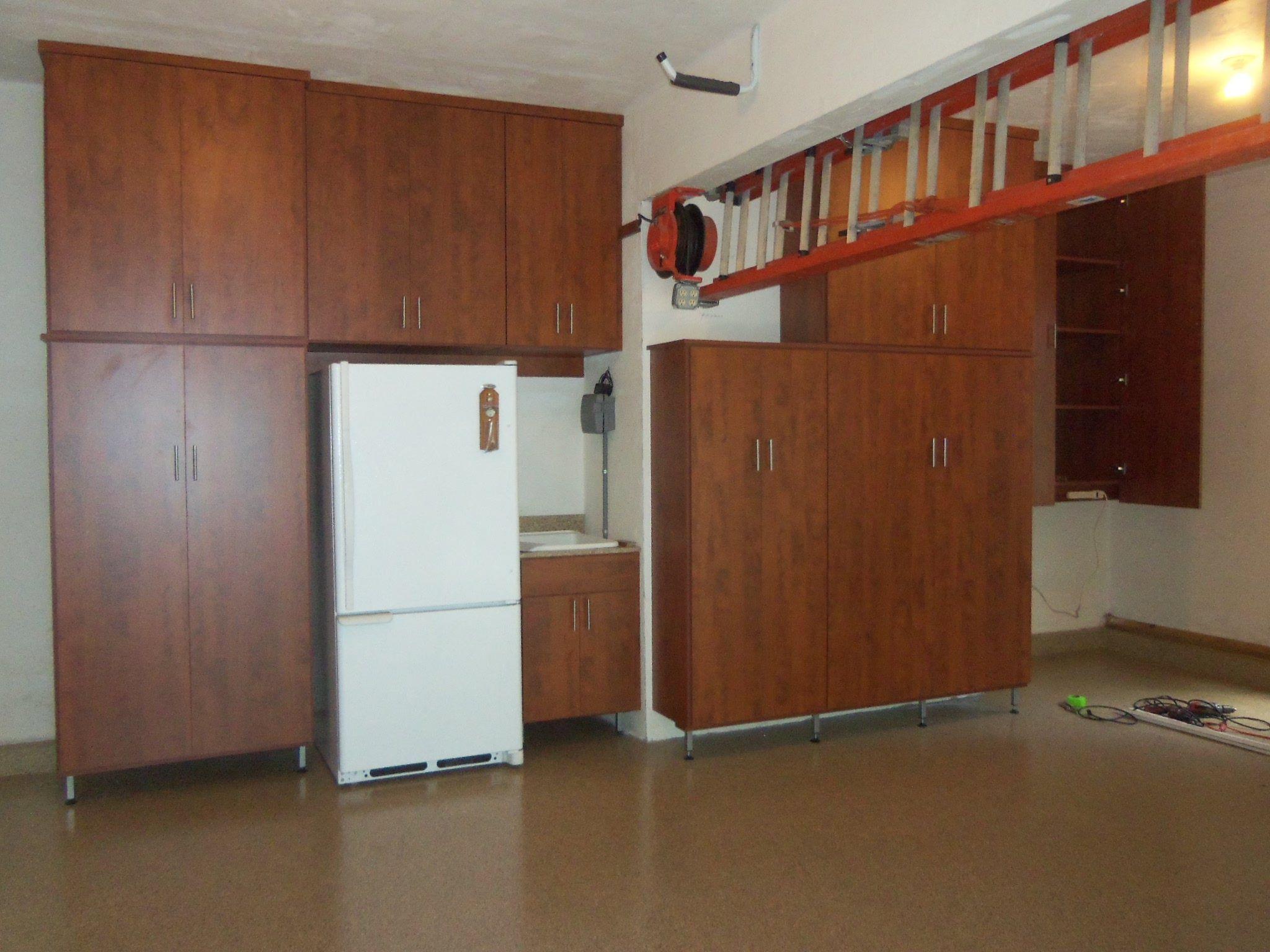 Custom garage cabinets in dark wood