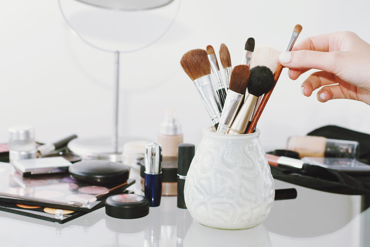Makeup brushes in small vase