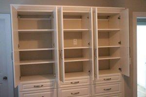 Custom cabinets in white opened Boston, MA