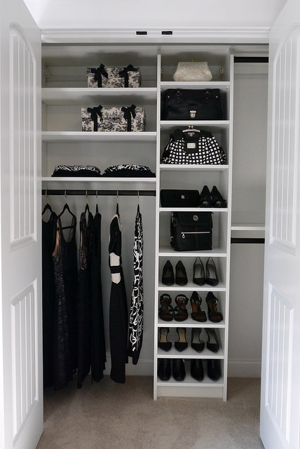 Reach-in closet with shelves and hanging areas