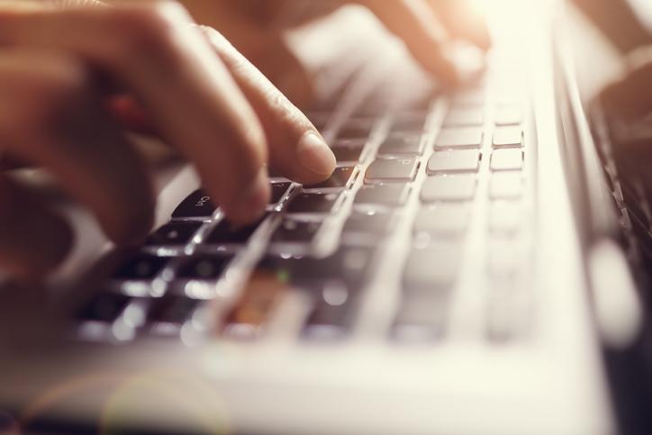 typing on illuminated laptop keyboard