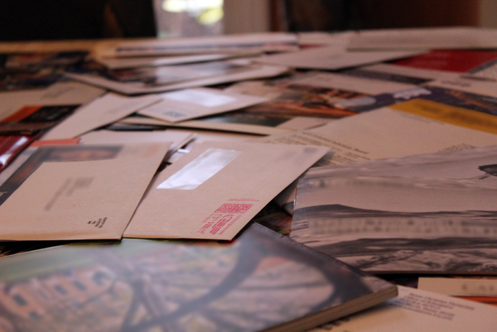 table covered with junk mail