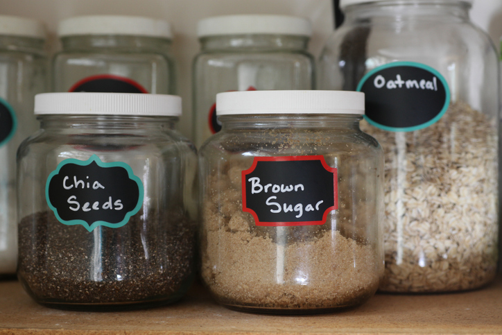 pantry jars with labels of ingredients