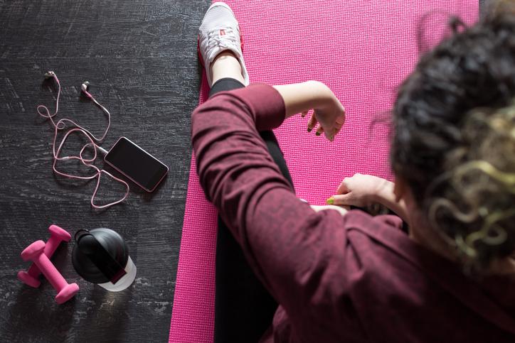 Female athlete resting on mat