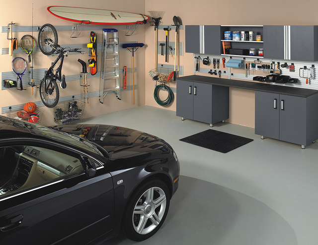 Custom storage in a garage with car.