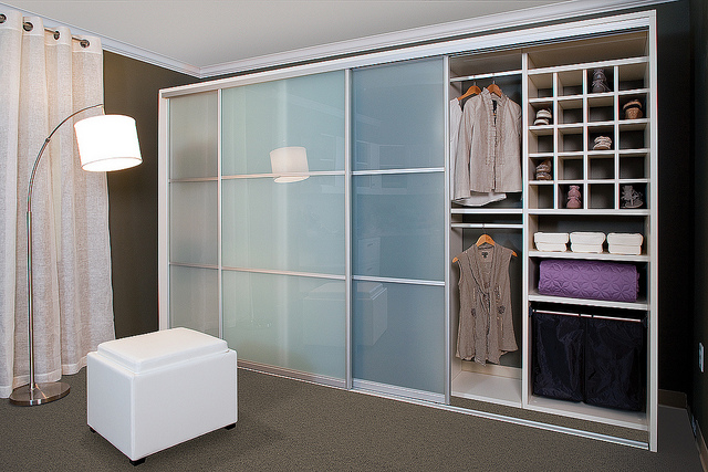 Small custom closet reach-in with sliding door