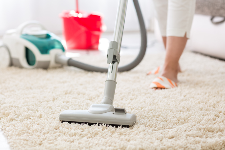 Vacuuming and cleaning carpet