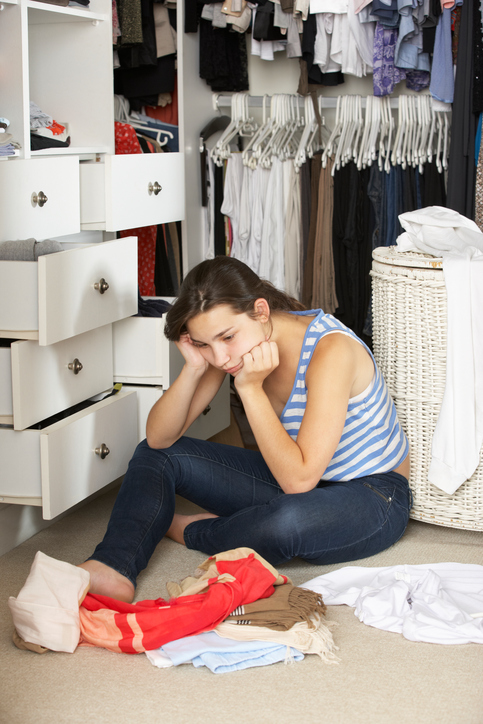 Unhappy teenager in closet