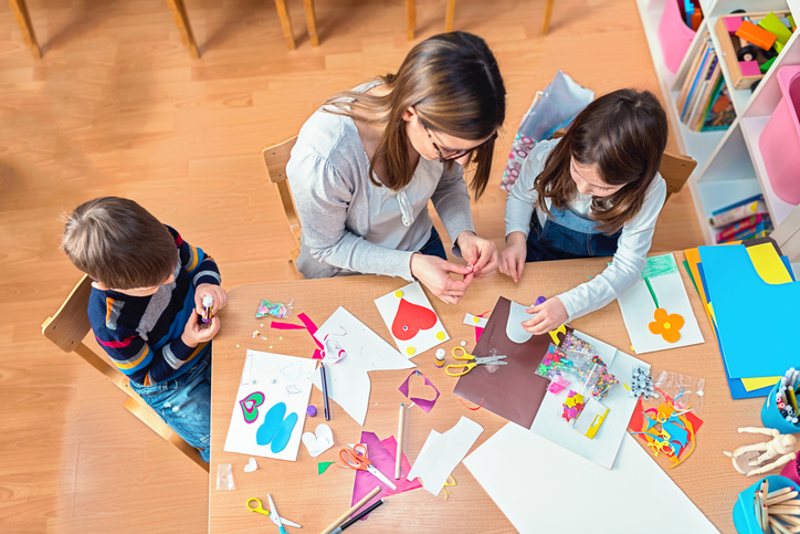 craft room with parent and kids