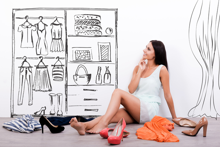 Woman thoughtfully thinking about custom closet