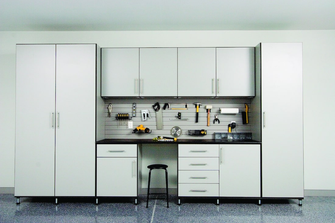 Grey garage cabinets and tool storage