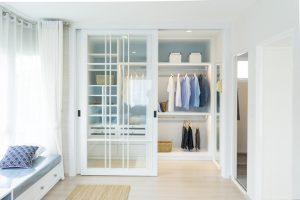 White coastal closet with bench and Outer Banks style Charlotte