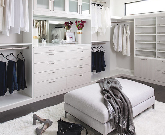 Glamorous walk-in closet with white color scheme