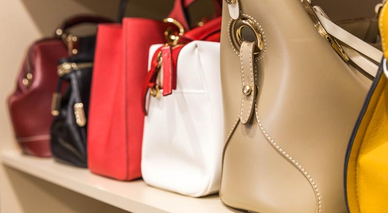 handbags on shelf in a custom closet