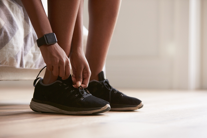 Runner tying up shoes