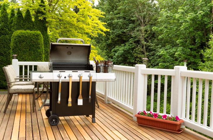 Clean BBQ and outdoor deck with cooler