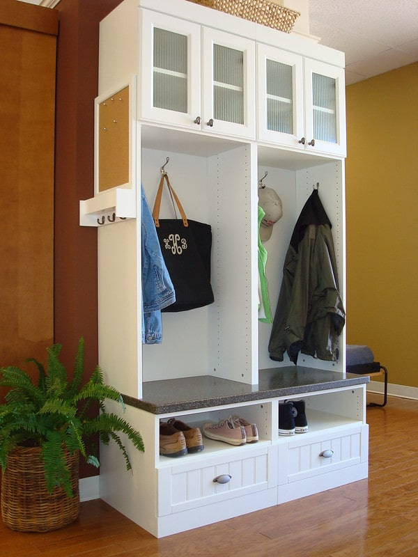 white entryway coat and clothing organizer