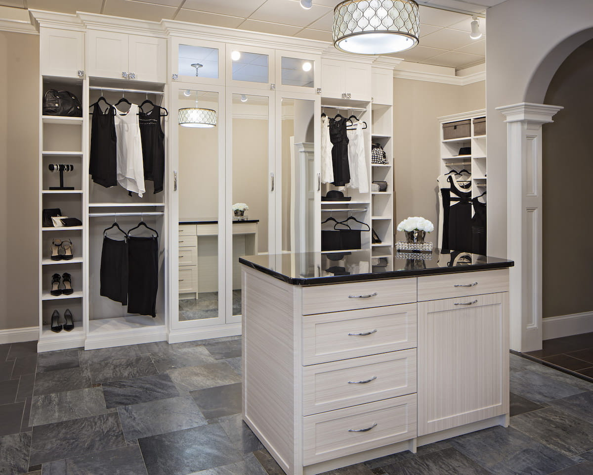 Organized walk-in closet prepped for summer