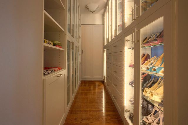 Small narrow closet with white cabinetry