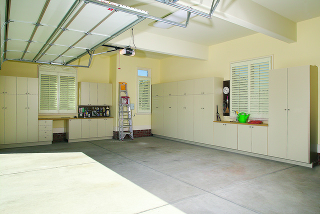Full organized garage with custom cabinetry