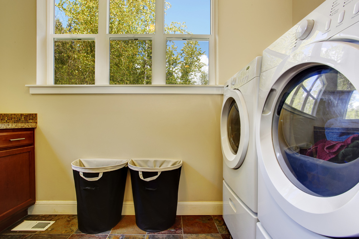 Clean modern laundry room with machines