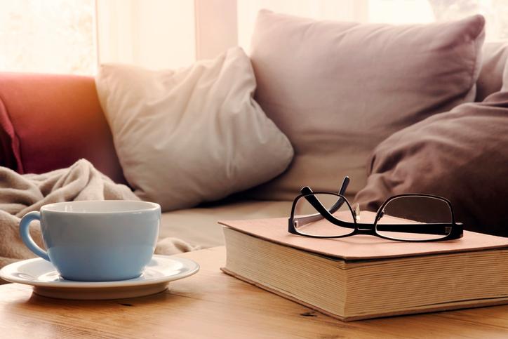 Cozy living room with book and mug