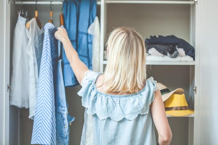 woman going through her closet
