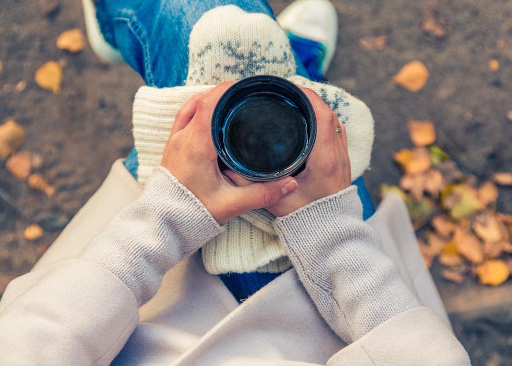 Cozy autumn leaves with tea