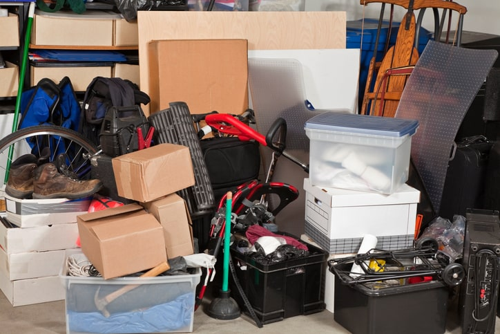 clutter and boxes in messy garage