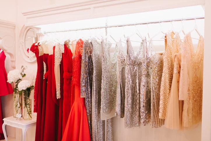 festive sparkly dresses in closet wardrobe
