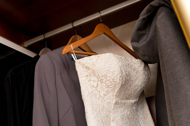 wedding dress hanging in closet storage