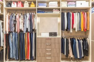 two-tone wood custom closet system with clothing and drawers