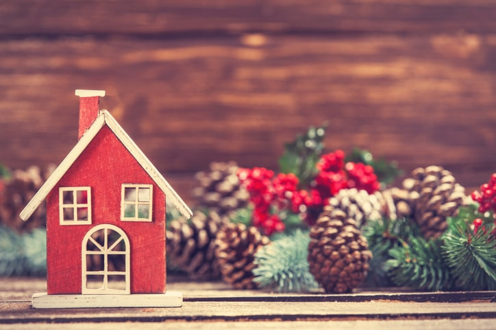 festive holiday decor red house with pine garland