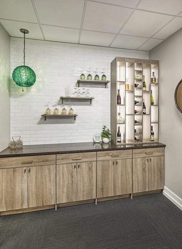 custom pantry wetbar storage with glasses on display