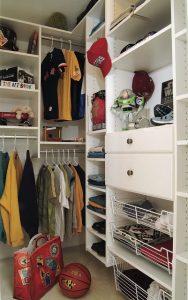 A boy's kid-friendly walk-in closet