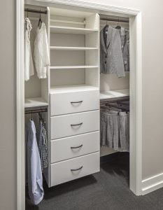 Reach-in closet with shelving and double hanging areas