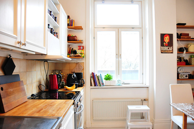 Small, organized kitchen with natural light