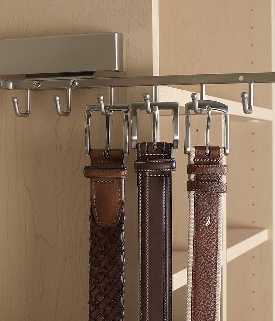 Modern slideout belt rack in a custom closet