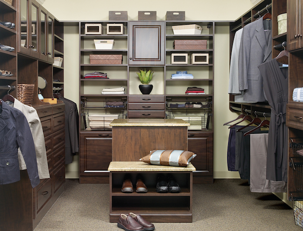 Custom closet with dark hardwood