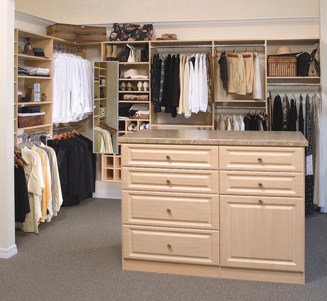 Custom maple wood closet.