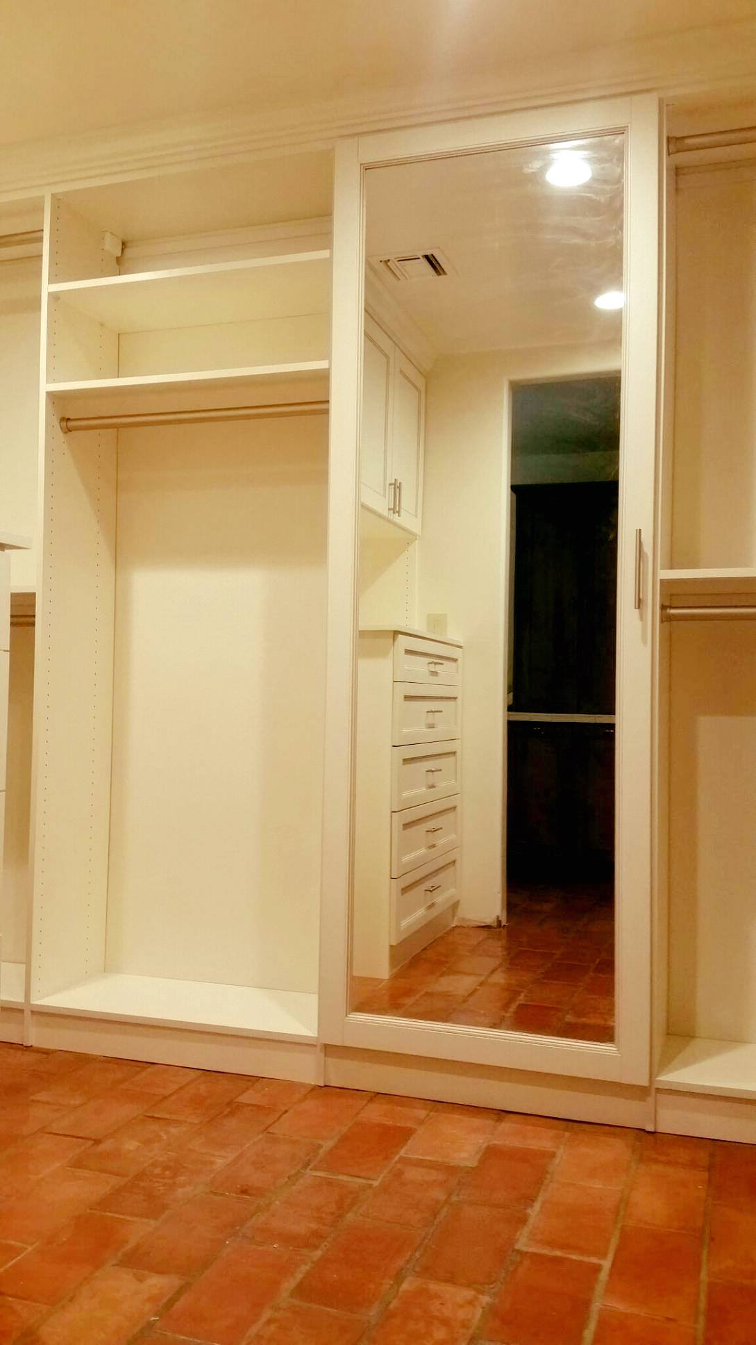 Mirror on built-in closet cabinet