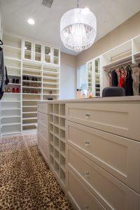 White custom closet shelves and island