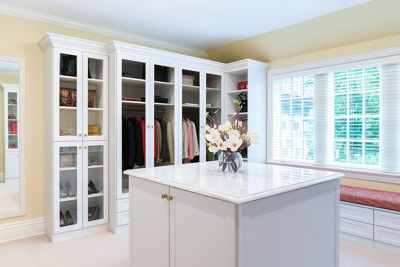 contemporary white walk-in closet with island Phoenix
