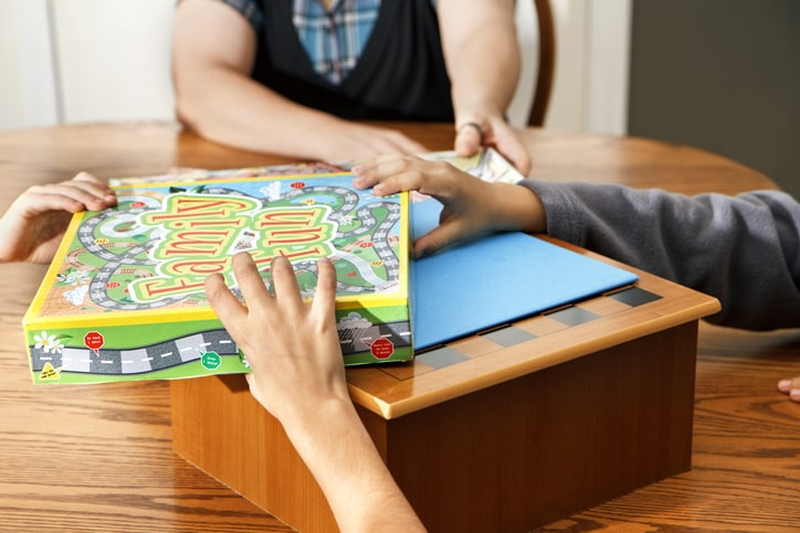 family picking board game to play