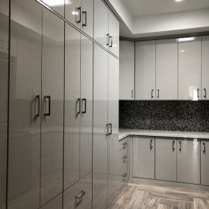 custom laundry room cabinets in glossy finish