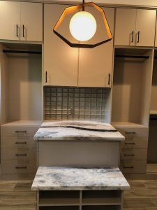 luxurious walk-in closet taupe cabinets