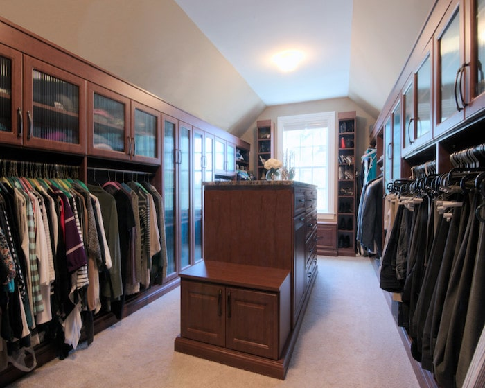 his and hers custom closet with island and bench Phoenix home