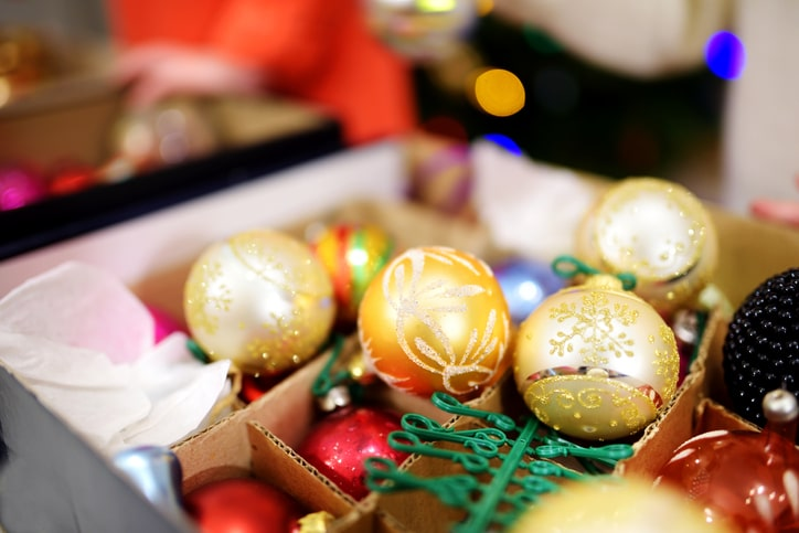 holiday ornaments and baubles unorganized in box