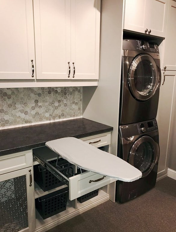 custom laundry room with iron board