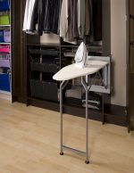 Fold out ironing board in closet system
